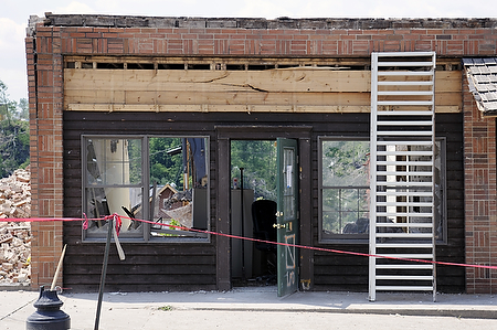A former attorney's office across from the old Morgan County Courthouse suffered extensive damage in the March 2 tornado. The rear of the building has been demolished since then. The building is shown here May 16.  Photo by Tom Eblen | teblen@herald-leader.com